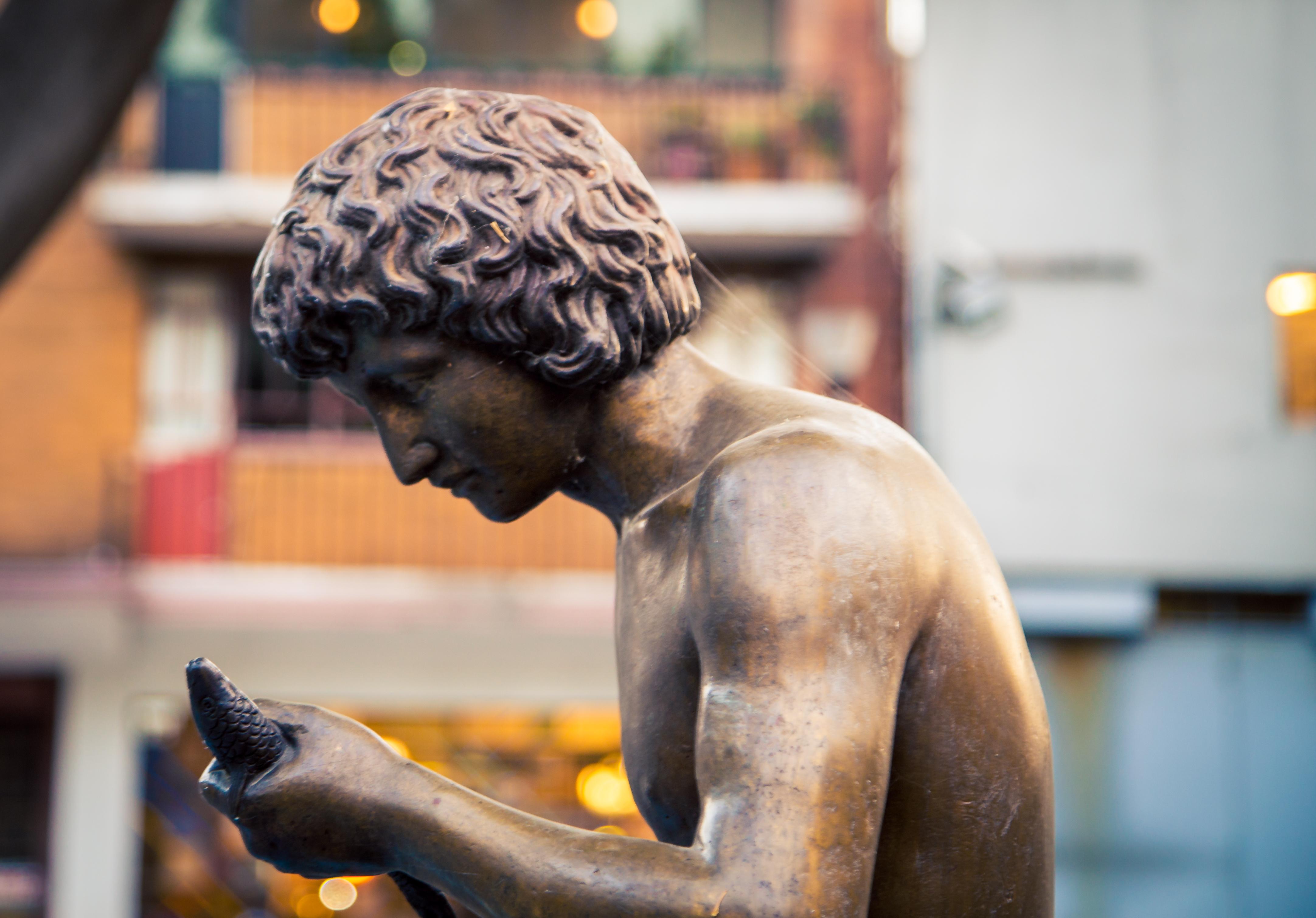 Statue of man cast in metal